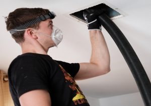 Man performing duct cleaning services